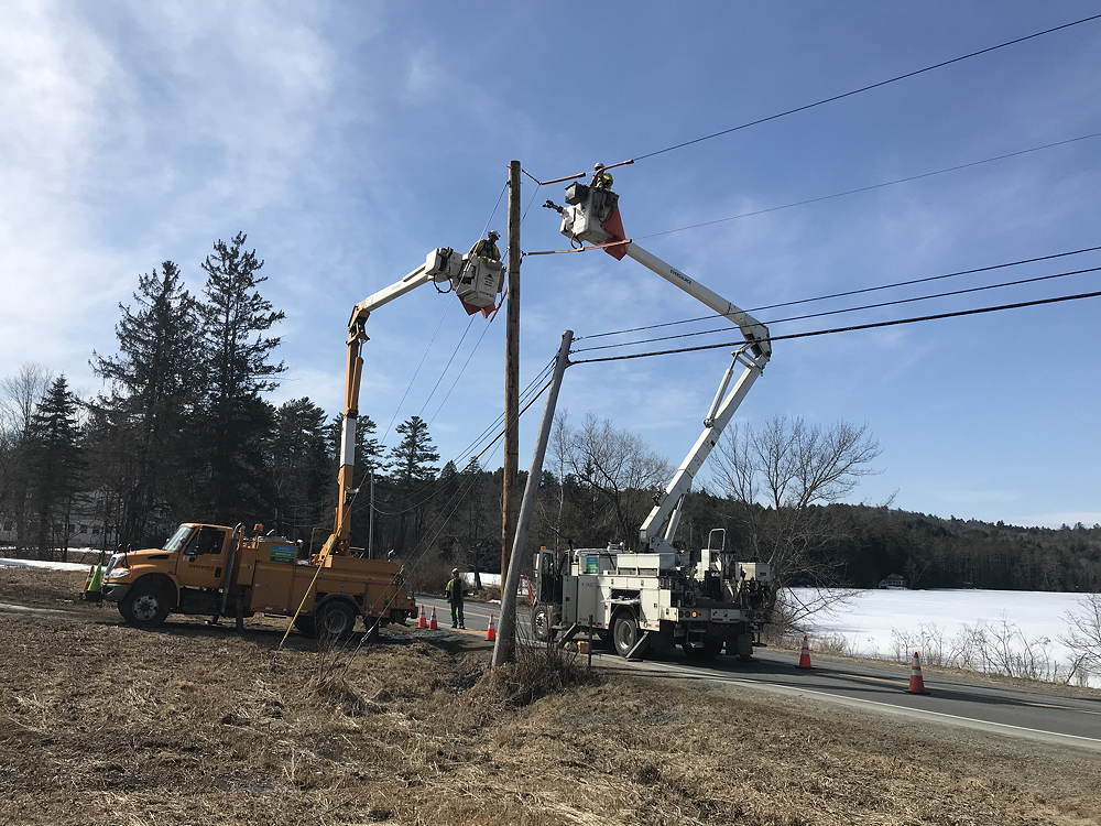 Eversource crews moving electric service to new pole near Post Pond, March 2020